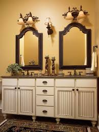 bathroom brown wellborn cabinets plus sink with mirror on the