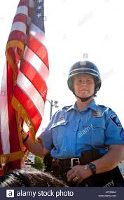 Minneapolis Flag Mounted Police Patrol Woman Riding Horse Carrying American Flag In