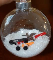 melted snowman ornament ribbon paper scissors