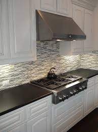black pearl leather granite countertops with a mosaic backsplash