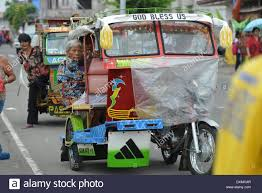 philippines motorcycle taxi motorcycle taxi in tacloban city on the philippines 10 03 2014