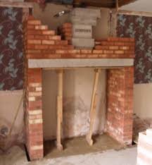 new build brick chimney with pumice liners for a wood stove