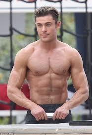 zac efron flexes incredible muscles shirtless