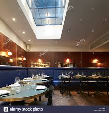 dining room with skylight and upholstered bench seating the