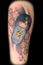 lovely matryoshka doll tattoo design photos pictures and