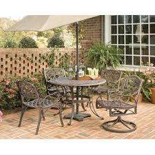 Patio Dining Set With Umbrella - 48 inch round outdoor patio table in rust brown metal with