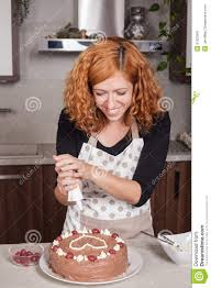 Decorating A Cake At Home Happy Woman Decorating Cake At Home Stock Photo Image 51525681