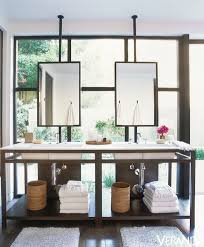 sleek bathroom design with ceiling mounted hanging mirrors over