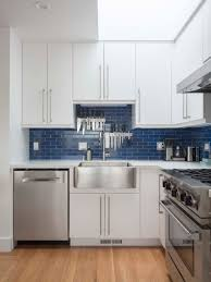 white kitchen cabinets with blue tiles elsie san francisco design build