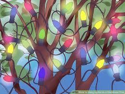 3 ways to hang lights on a christmas tree wikihow