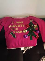 maternity ugly christmas sweater arrow points to baby bump