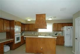 painting over kitchen cabinets painting vs staining kitchen cabinets faced