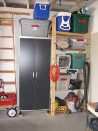 garage using a locked storage cabinet to organize hazardous items