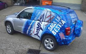 car wrapped in wrapping paper vehicle wraps vehicle wrapping vehicle graphics vinyl wraps