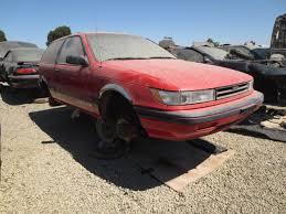 mitsubishi mirage coupe jdm junkyard find 1989 mitsubishi lancer wait i mean plymouth colt
