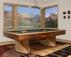 wooden classy billiard table with large windows for bright room