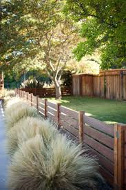 lowes contractors landscape transitional with front yard grasses