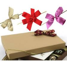 gift boxes with bow gift bows and stretch loops box and wrap