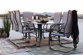 seven piece traditional patio dining set with sling chairs in grey