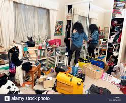 messy bedroom clothes stock photos messy bedroom clothes stock teenage girl in untidy bedroom stock image