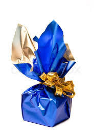 blue and gold ribbon christmas present in a shiny blue box with gold ribbon at white