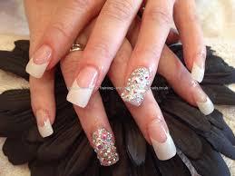full set of acrylic nails with gun metal gel polish and swarovski