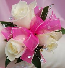 pink corsage white sweetheart corsage pink