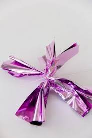 mylar wrapping paper diy fringe mylar poms for new year s christmas decor and