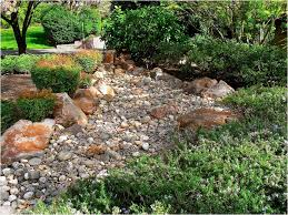 river rock forms a triple threat in this backyard pictures of