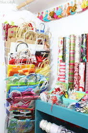 how to store wrapping paper and gift bags organizing with style an organized gift wrap closet blue i style
