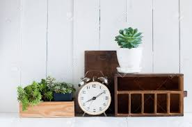 vintage home decor old wooden boxes houseplants alarm clock vintage home decor old wooden boxes houseplants alarm clock on white wooden board