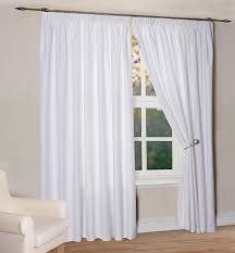 spiffy single white curtains and white ribbon accesories added