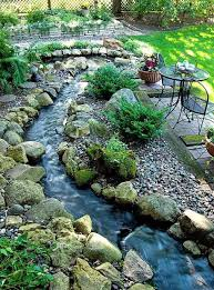backyard landscaping ideas with small river and rocks