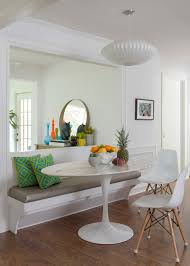 furniture banquette bench with green cushions and oval dining