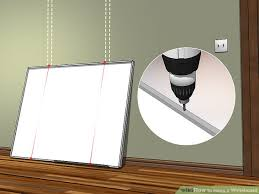 how to hang a picture frame 3 ways to hang a whiteboard wikihow