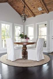 slipcovered parsons chairs dining area with slipcovered parsons chairs and pedestal table and
