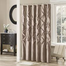 grey glossy satin fancy curtains with rounded mirror frame and