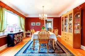 red dining room with hardwood floor and rug furnishes with rustic