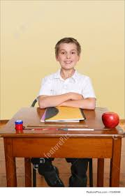 Picture Of Student Sitting At Desk by Happy School Student Stock Image I1348444 At Featurepics