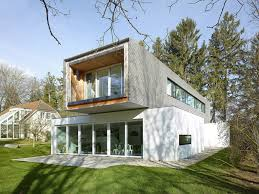 j e custom home designs inc cantilevered tannay bridge house in switzerland makes the most of