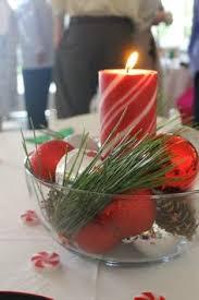 poinsettia reception table centerpiece at a christmas wedding in
