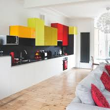 Orange And White Kitchen Ideas White Kitchen With Colourful Units The Coloured Cabinets Act As A