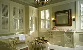 french country bathroom with louvered windows and low tub also