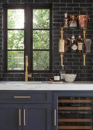 Glossy Black Wet Bar Backsplash With Glass And Brass Shelves - Bar backsplash
