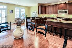 traditional kitchen with raised panel hardwood floors in