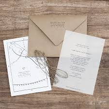 vellum and kraft paper wedding invitations with a hand drawn map