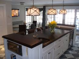 wide plank walnut island countertop with raised ends brooks custom