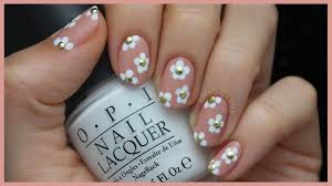 this cute studded daisy nail art is perfect for spring