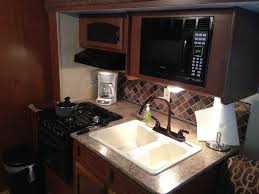 view of kitchen are including microwave sink counter top range