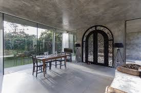 striking concrete and glass home has a twist curbed